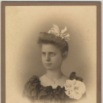 Image of Cabinet photo of a young woman posed in photographer's studio, Hoboken, no date, probably 1895-1900. - Photograph, Cabinet