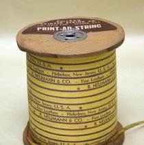Image of Spool of printed ribbon: R. Neumann & Co., Fine Leathers, Hoboken, New Jersey, U.S.A. No date, ca. 1960's-1970's. - Ribbon