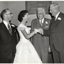 Image of Digital image of B+W photo of Paula Millenthal being congratulated by former Senator Albert Hawkes at commencement, Stevens Hoboken Academy, Hoboken, June 9, 1955. - Print, Photographic
