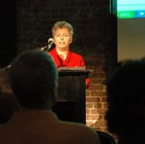 Image of Color photos, 7, of Valerie D'Antonio presenting a slide lecture for Secret Gardens Tour, Hoboken, May 20, 2006. - Photograph