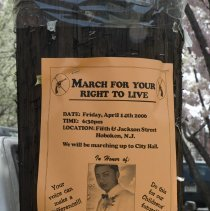 """Image of Color photo of poster on pole announcing march in honor of Ismar """"Mooky"""" Mineros, murder victim, on April 14, Hoboken, April 12, 2006. - Photograph"""
