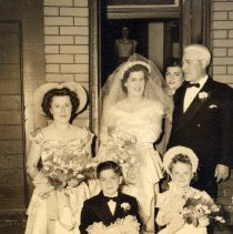Image of Digital image of sepia-tone photo of a wedding party at front entrance of 509 Monroe St., Hoboken, no date, ca. 1940-1950. - Photograph
