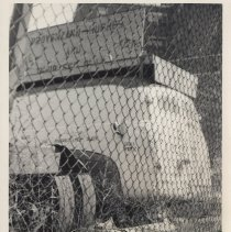 Image of B+W photo of trash near fence belonging to Diamond Reo of Hudson County, 8th & Madison Sts., Hoboken, no date, ca. 1970-1980. - Print, Photographic