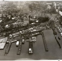 Image of B+W negative: aerial view of Stevens Institute of Technology campus & Penn Central Railroad waterfront facilities, Hoboken, no date, ca. 1968-1975. - Negative, Film