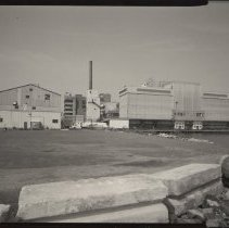 Image of B+W photo of former Maxwell House Coffee plant exterior, overview from east, Hoboken, 2003. - Print, Photographic