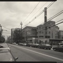 Image of B+W photo of former Maxwell House Coffee plant exterior, overview looking north on Hudson St., Hoboken, 2003. - Print, Photographic