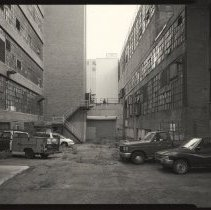 Image of B+W photo of former Maxwell House Coffee plant exterior, between Manufacturing Building & Extraction Building, Hoboken, 2003. - Print, Photographic