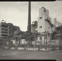 Image of B+W photo of former Maxwell House Coffee plant exterior, looking northwest from Pilot Plant, Hoboken, 2003. - Print, Photographic