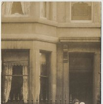 Image of Photo postcard of woman holding baby plus three young girls and a boy on front steps of unidentified building, probably Hoboken, no date, ca. 1910. - Print, Photographic