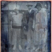 Image of Tintype photo of a man, possibly J. Widmann with two woman (also possibly family members), no place, no date, ca. 1900. - Tintype