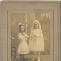 Image of Sepia-tone photo of two young girls posed in photographer's studio, Union Hill, N.J., no date, ca. 1910-1920. - Print, Photographic