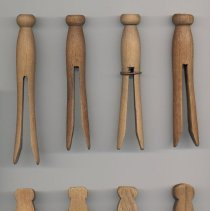 Image of selected single piece wood pins, flat and round