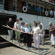 "Image of Color photos, 9, of people attending a brunch aboard the ferry ""Yankee"" moored at pier 12, Hoboken, June 5, 2007. - Photograph"