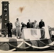 Image of B+W photo of ceremony with John J. Grogan et al aboard a ship, probably docked in Hoboken, no date, ca. 1953-1959. - Print, Photographic