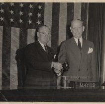 Image of B+W photo of Frank Hague (right) handing gavel to Frank Hague Eggers, Jersey City, 1947 - Print, Photographic