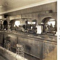 Image of Sepia-tone photo of interior of Clam Broth House lounge (bar), 30 Newark St., Hoboken, no date, circa 1950. - Print, Photographic