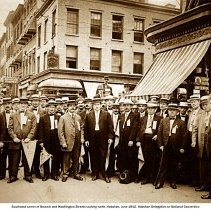 Image of Sepia-tone photo of southeast corner of Newark & Washington Sts. looking north with Hoboken Delegation to National Convention, Hoboken, June 1912. - Print, Photographic