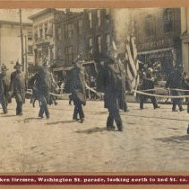 Image of Sepia-tone of Hoboken firemen marching in Washington St. parade looking north to Second St., Hoboken, ca. 1900-1905. - Print, Photographic
