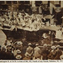 Image of Sepia-tone photo of Washington St. near Third St. during 'Safe & Sane' July Fourth parade, Hoboken, 1913. - Print, Photographic