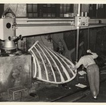 Image of B+W photo of a man calibrating a machine with propeller blade inside Ferguson Propeller Works, Hoboken, no date, ca.1975-1980. - Print, Photographic