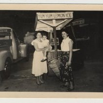 Image of Digital image of b+w photo of Lucy Principe (left) holding Lucille Conti & Ann D'Atilla near a Yum Yum cart & truck, 416 Clinton St., Hoboken, n.d., ca. 1950s. - Print, Photographic