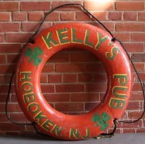 Image of Sign, painted ring life preserver, from Kelly's Pub, 1314 Washington St., Hoboken, removed October 2007. - Sign