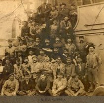 Image of Sepia tone photo of shipyard workers posed on deck of the U.S.S. Georgia at Bath Iron Works, Bath, Maine. No date, circa May 1906. - Print, Photographic