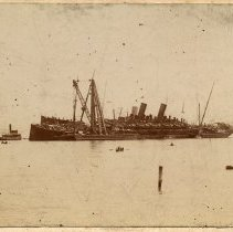 Image of Sepia-tone photo of the S.S. Bremen & S.S. Main, Weehawken Cove after the Hoboken pier fire, ca. June 30, 1900. - Print, Photographic