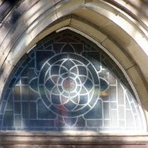 Image of 15: detail of stained glass above main entrance