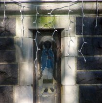 Image of 17: detail baptistery, front view of narrow (lancet) window; stained glass