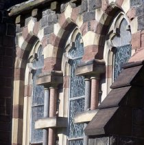 Image of 27: lateral view of windows in image 26, east facade