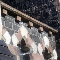 Image of 28: lateral view of corbels, east facade