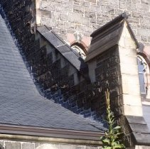 Image of 34: partial view of buttress, shingled roof, east facade