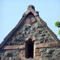 Image of 39: partial view of top of north facade; note reinforcements