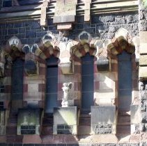 Image of 40: four windows with ange sculpture, northt facade