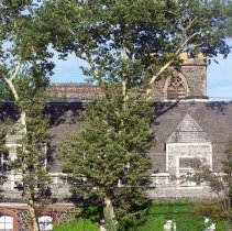 Image of 44: view east of upper part of parish house; church behind