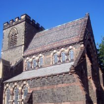 Image of 8: Partial SW veiw of east facade; lateral view of buttresses.