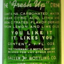 Image of detail text on back; Galler 7up Bottling Co.