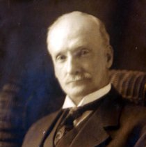Image of Color photo of Mayor Lawrence Fagan photo on display in Hoboken City Hall. - Print, Photographic