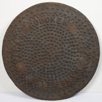 Image of Coal chute cover or drain cover lettered Hoboken and Mansfield & Fagan. N.d., circa 1890-1920. - Cover, Drain