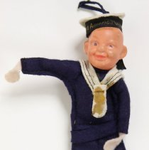 Image of Souvenir doll: Holland America Line Cruises sailor with printed hat band. No date, probably 1950s-1960s. - Doll