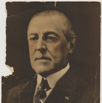 Image of Souvenir card with color photo of President Woodrow Wilson issued by Frank Cordts Furniture Co., Hoboken, ca. 1918-1919. - Card, Souvenir