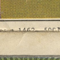 Image of detail outside cover at fold: form number and date code