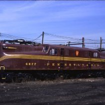 Image of Color slide of former Pennsylvania Railroad GG-1 locomotive No. 4877 in Hoboken rail yard, March 11, 1989. - Transparency, Slide