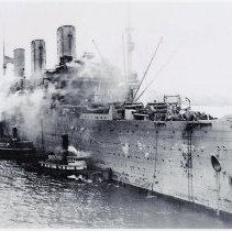 Image of B+W photo of U.S.S. Leviathan approaching dock at Hoboken [Port of Debarkation] with 8,000 troops aboard. N.d., ca. 1918-1919. - Print, Photographic