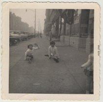 Image of Photo 3: three girls playing on sidewalk, Oct. 1960
