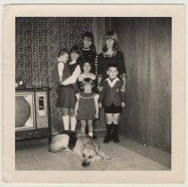 Image of photo 4: Peskens children inside home at 1224 Washington St.
