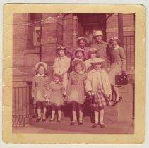 Image of photo 5: girls(Peskens et al) on steps outside Elysian Flats, Easter 1958