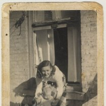 Image of photo 1: Polly Peskens with child, Phyllis Peskens, River St. rooftop, 1952