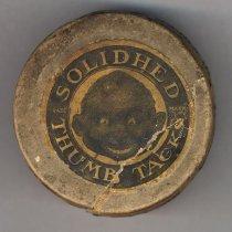 Image of top; printed label Solidhed Thumb Tacks